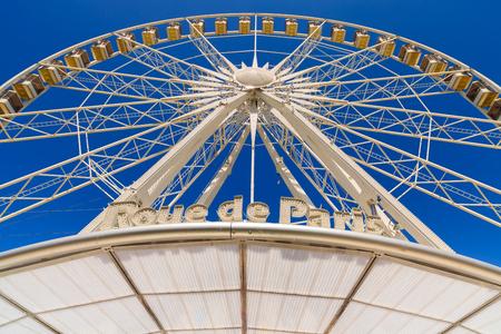 parisian: Roue de Paris ferris wheel in the Jardin de Tuileries in Paris, France. Stock Photo