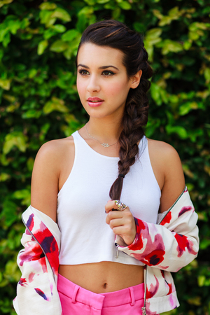 braided hair: Beautiful young woman in a outdoor setting. Stock Photo