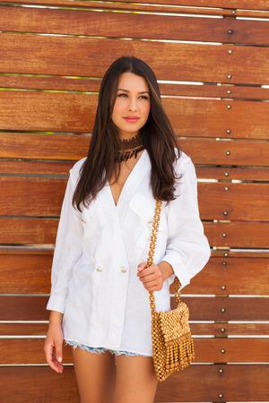 Beautiful young woman in a outdoor fashion setting. photo