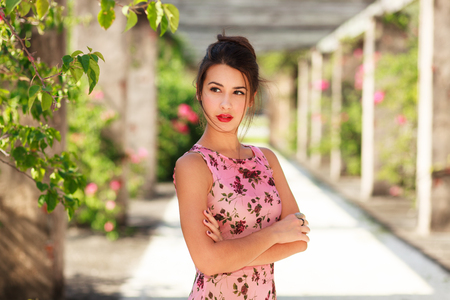 Beautiful young woman in a outdoor setting. Stock Photo