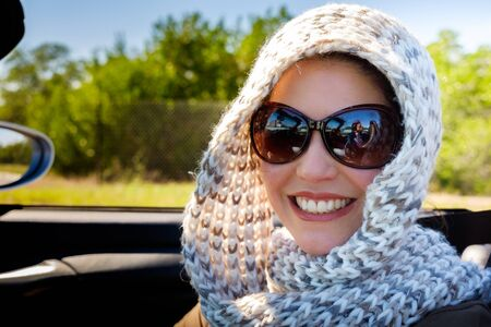 burka: Beautiful middle age woman outdoor portrait in automobile. Stock Photo