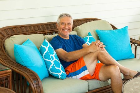 unshaven: Handsome unshaven middle age man outdoor portrait in a home setting.