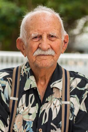 aging american: Elderly eighty plus year old man outdoor portrait. Stock Photo