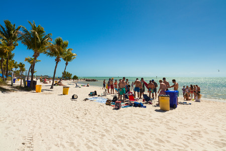 Key West, Florida USA - March 3, 2015: Young college students enjoying spring break on a Key West beach in Florida.