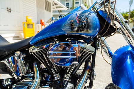 Key West, Florida USA - March 3, 2015: Close up view of a custom motorcycle with a Nine Eleven tribute painting on the gas tank.