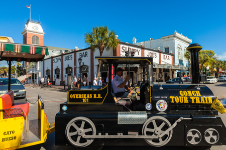 Key West, Florida USA - March 3, 2015: The historic Sloppy Joes Bar on Duval Street in downtown Key West with the Conch Train.