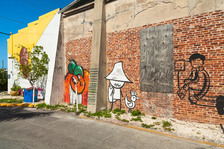 bahama: Key West, Florida USA - March 2, 2015: A vintage brick building covered with graffiti art in the Bahama Village District of Key West.