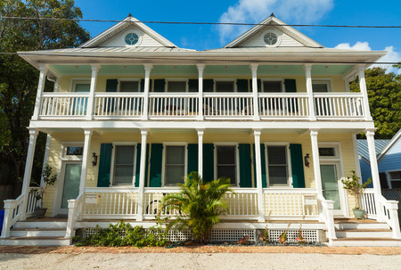 residential home: Key West, Florida USA - March 2, 2015: Typical wood frame architecture style home in the residential Historic District of Key West. Editorial
