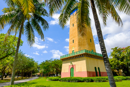 gables: Coral Gables, FL USA - April 4, 2015: The beautifully restored Alhambra Water Tower in the Spanish style influenced neighborhood of Coral Gables in Miami.