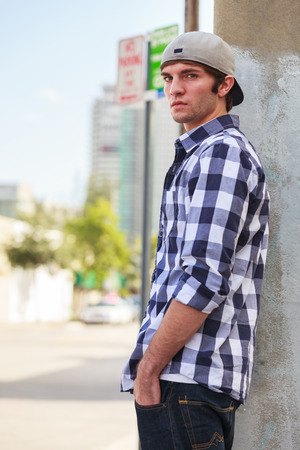 young man: Handsome young man outdoor fashion portrait.