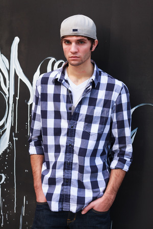 handsome young man: Handsome young man outdoor fashion portrait.