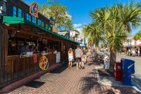 key: Key West, Florida USA - March 3, 2015: Popular restaurants and bars along Greene Street and Duval in downtown Key West. Editorial