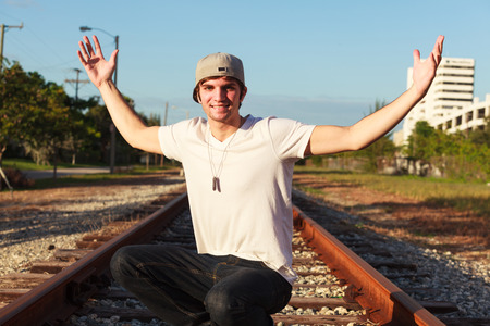 baseball hat: Handsome young man outdoor fashion portrait Stock Photo