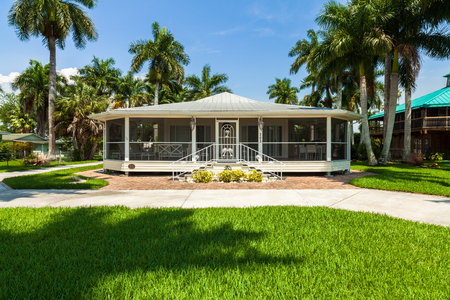rural community: Everglades City, FL USA - May 20, 2015: Typical wood frame style home with wrap around porch located in the rural community of Everglades City. Editorial