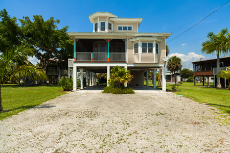 rural community: Everglades City, FL USA - May 20, 2015: Typical wood frame platform style home located in the rural community of Everglades City. Editorial
