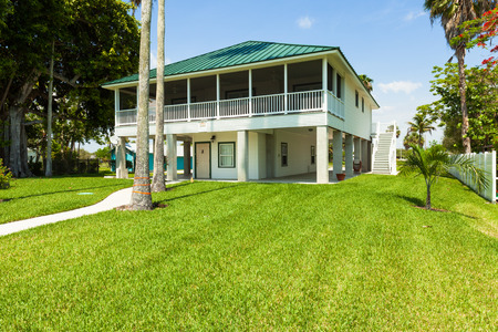 fl: Everglades City, FL USA - May 20, 2015: Typical wood frame platform style home located in the rural community of Everglades City. Editorial