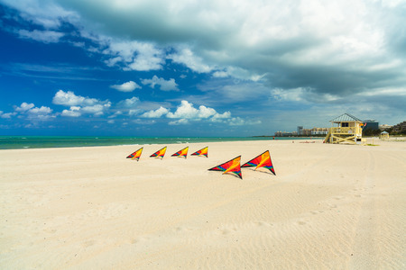 key biscayne: Pretty colorful kites ready for flight on the beach. Stock Photo