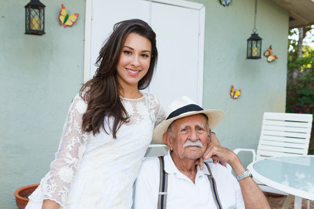 octogenarian: Elderly eighty plus year old man with granddaughter in a outdoor home setting.