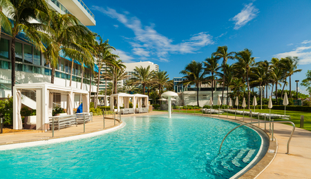 cabana: Miami Beach, FL USA - Octobet 3, 2012: The beautiful pool area of the historic art deco Fontainebleau Hotel on Miami Beach. Editorial