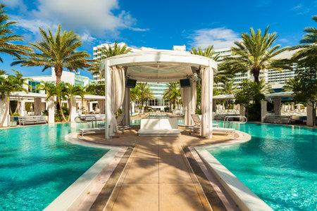 swimming pool: Miami Beach, FL USA - Octobet 3, 2012: The beautiful pool area of the historic art deco Fontainebleau Hotel on Miami Beach. Editorial