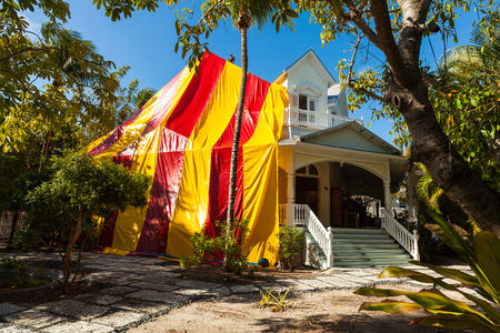 pest control: Key West, FL USA - March 9, 2015: Vintage wooden house covered by a tent for termite treatment.