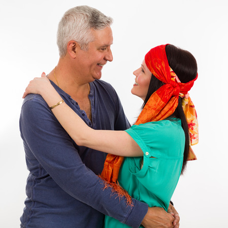 middle age couple: Attractive middle age couple studio portrait on a white background.