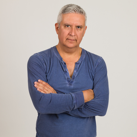 middle age man: Handsome middle age man studio portrait on a light gray background.