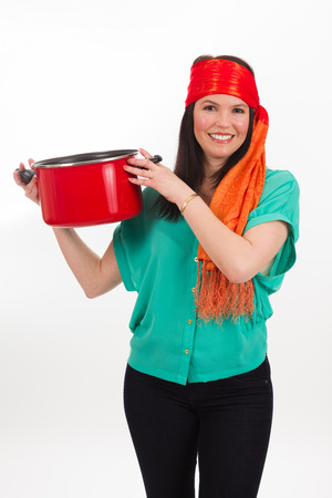 fair skin: Pretty middle age woman wearing a colorful bandana holding a kitchen pot on a white background.