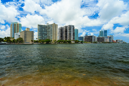 key biscayne: Beautiful Miami skyline along Biscayne Bay from Key Biscayne with tall Brickell Avenue condos in the background. Stock Photo