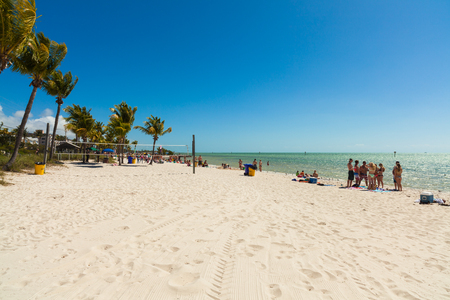 key west: Key West, Florida USA - March 3, 2015: Visitors enjoying the perfect weather and beauty of the Key West beach in Florida. Editorial