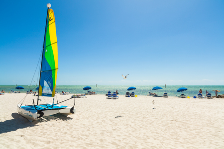 hobie: Key West, Florida USA - March 3, 2015: Visitors enjoying the perfect weather and beauty of the Key West beach in Florida. Editorial