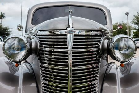 grille: Key Largo, FL USA - June 14, 2015: Close up view of the front end of a beautifully restored 1938 Chevrolet model Coupe.