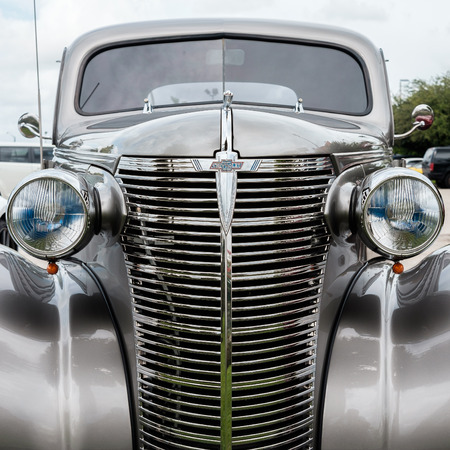 restored: Key Largo, FL USA - June 14, 2015: Close up view of the front end of a beautifully restored 1938 Chevrolet model Coupe.
