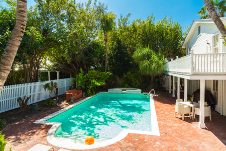 florida house: Key West, Florida USA - March 2, 2015: A pretty swimming pool and guest house in the historic district of Key West.