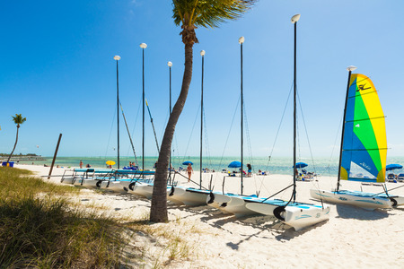 Key West, Florida USA - March 3, 2015: Visitors enjoying the perfect weather and beauty of the Key West beach in Florida. Editorial