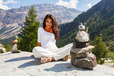 Beautiful young lady enjoying the beauty of the Swiss mountains. Stock Photo - 42857022