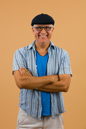 spanish looking: Handsome unshaven middle age man studio portrait with a beige background. Stock Photo