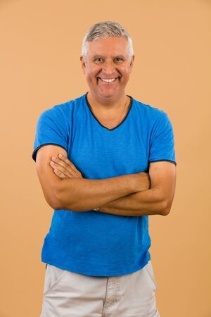t shirt model: Handsome unshaven middle age man studio portrait with a beige background. Stock Photo