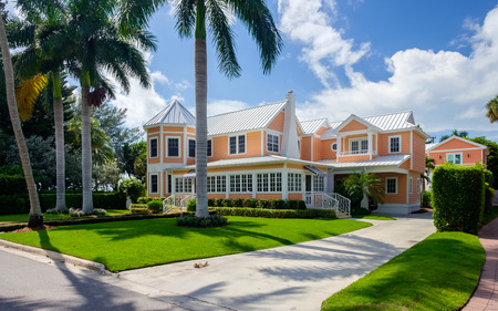 Naples, Florida USA - July 28, 2015: Beautiful vintage wood frame architecture style home in the coastal residential historic district of Naples.