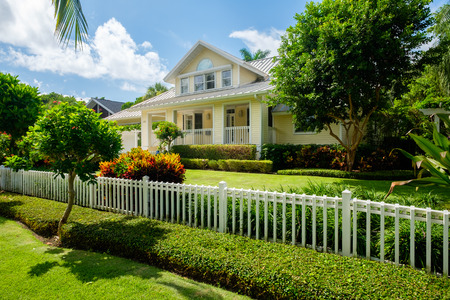 Naples, Florida USA - July 28, 2015: Beautiful wood frame architecture style home in the coastal residential historic district of Naples.