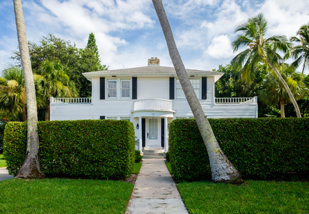 naples: Naples, Florida USA - July 28, 2015: Typical vintage wood frame architecture style home in the coastal residential historic district of Naples.