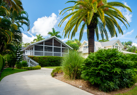 ��wood frame�: Naples, Florida USA - July 28, 2015: Beautiful vintage wood frame architecture style home in the coastal residential historic district of Naples.