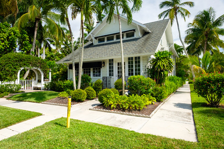 Naples, Florida USA - July 28, 2015: Typical vintage wood frame architecture style home in the coastal residential historic district of Naples.
