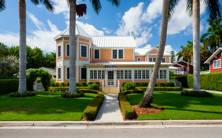 florida: Naples, Florida USA - July 28, 2015: Beautiful vintage wood frame architecture style home in the coastal residential historic district of Naples.
