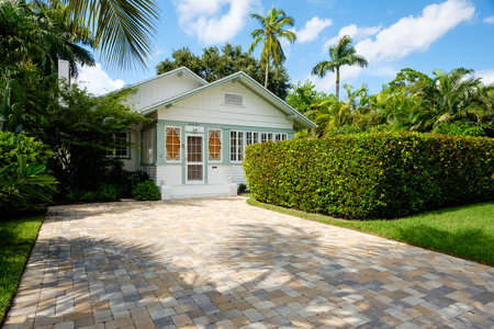 ��wood frame�: Naples, Florida USA - July 28, 2015: Typical vintage wood frame architecture style home in the coastal residential historic district of Naples.