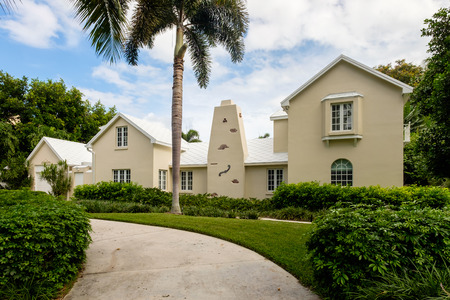 residential home: Naples, Florida USA - July 28, 2015: Unique stucco architecture style home in the coastal residential historic district of Naples. Editorial