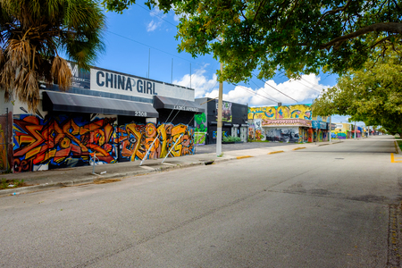 commercial real estate: Miami, Florida USA - October 4, 2015: The  urban Wynwood area in midtown has become a popular tourist destination to view the colorful graffiti art murals that cover the facades of commercial warehouse style buildings.