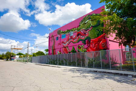 city building: Miami, Florida USA - October 4, 2015: The  urban Wynwood area in midtown has become a popular tourist destination to view the colorful graffiti art murals that cover the facades of commercial warehouse style buildings.