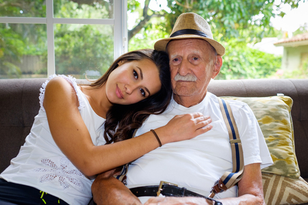 old man happy: Elderly eighty plus year old man with granddaughter in a home setting.