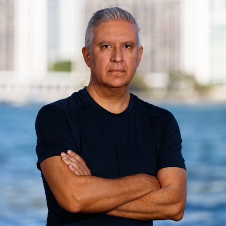 middle age man: Handsome middle age man outdoor portrait with a downtown bay skyline background. Stock Photo